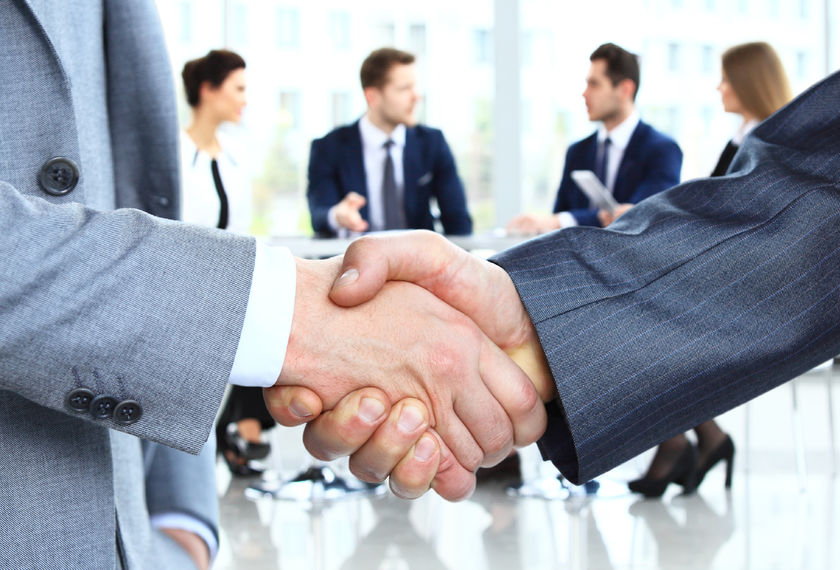 48074295 - closeup of a business handshake. business people shaking hands, finishing up a meeting